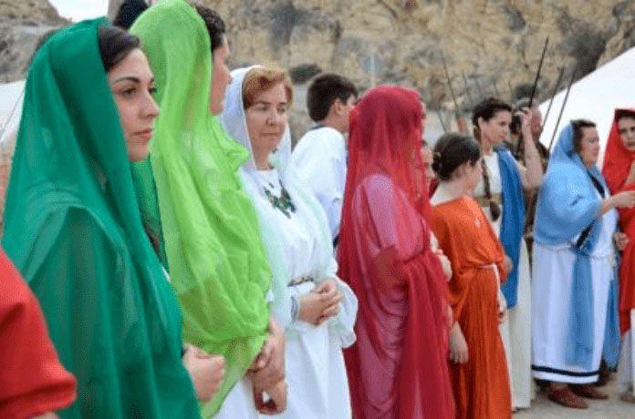 Women dressed as romans in recreation of festvm alonis la vila joiosa